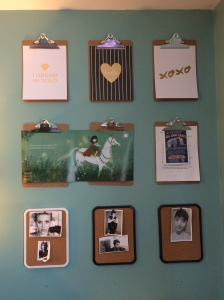 Clipboard wall for inspiration and character photos.